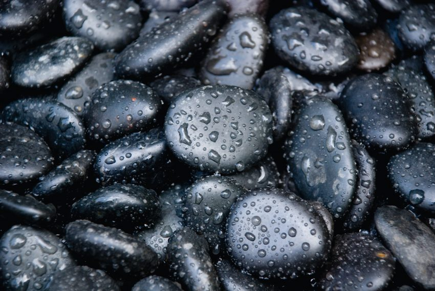 black stones with water dew