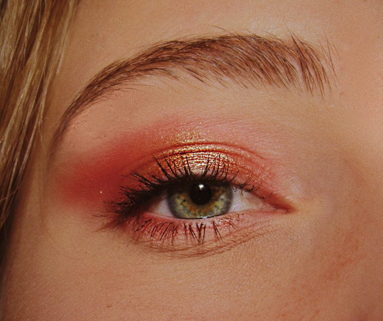 woman with pink and gold eyeshadow makeup