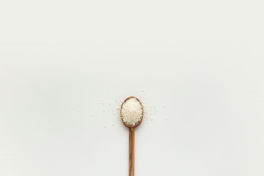 white powder on brown wooden spoon